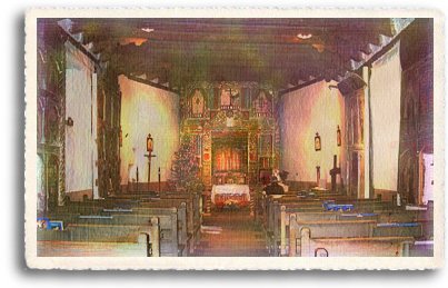 The interior of el Santuario de Chimayo is a rustic chapel which is dwarfed by its magnificent carved altar.